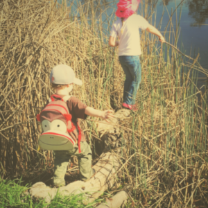 Gross motor skills. Balancing and fishing with a stick at Adventure School