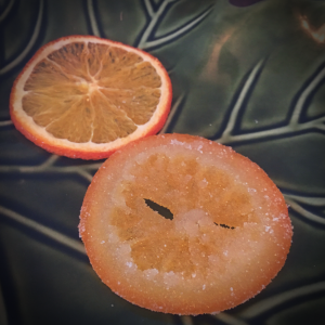 Compare dehydrated orange to candied orange